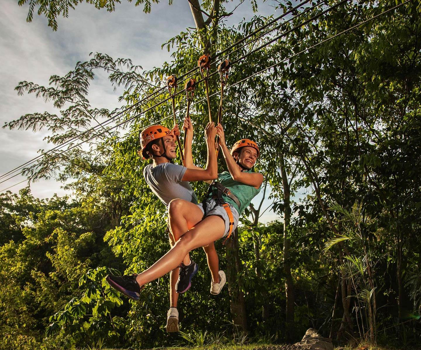 Fly across the Mayan jungle in an impressive zip-lines track!