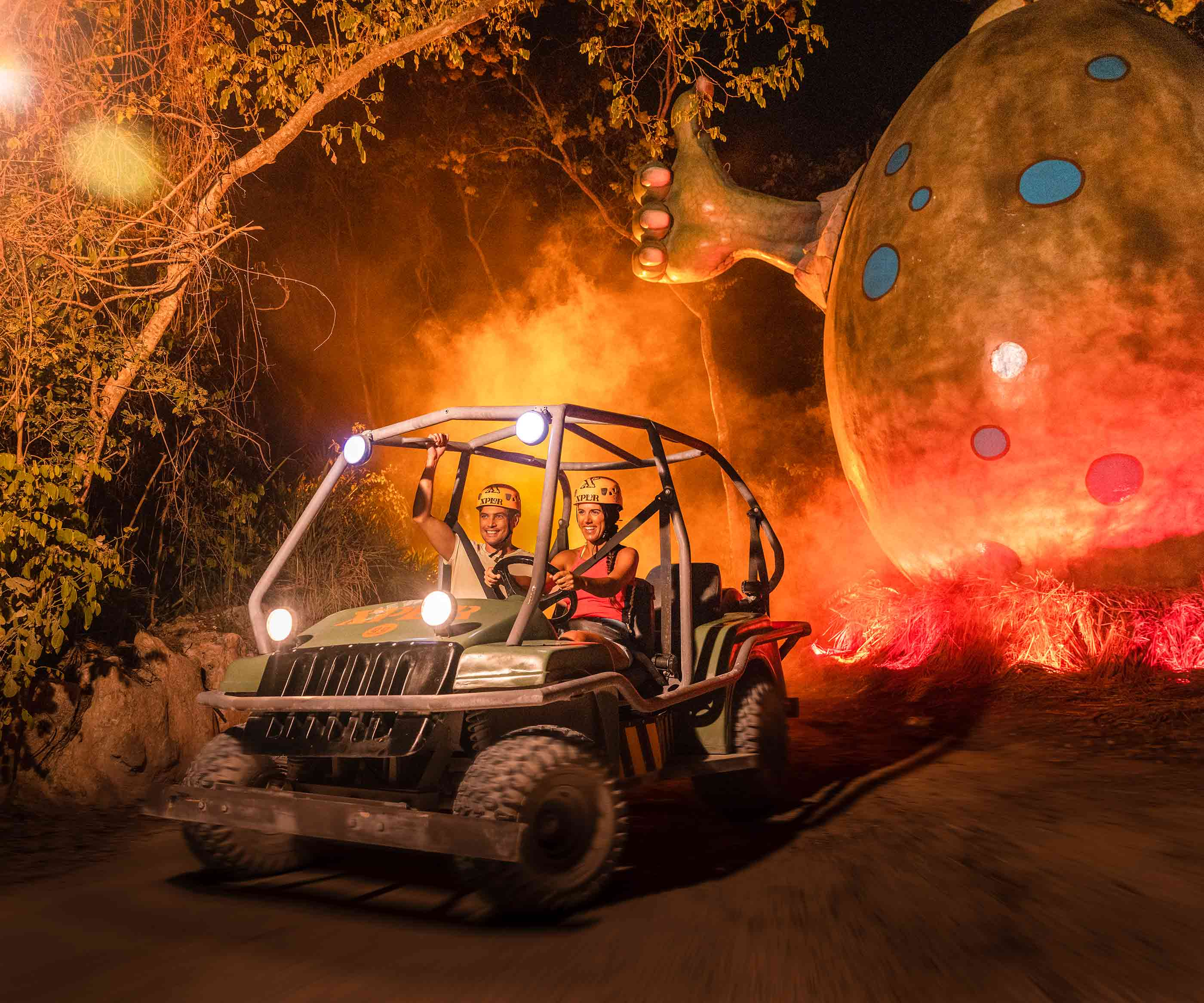 Drive an amphibious vehiche at night and explore the Mayan jungle at the Xplor Fuego park