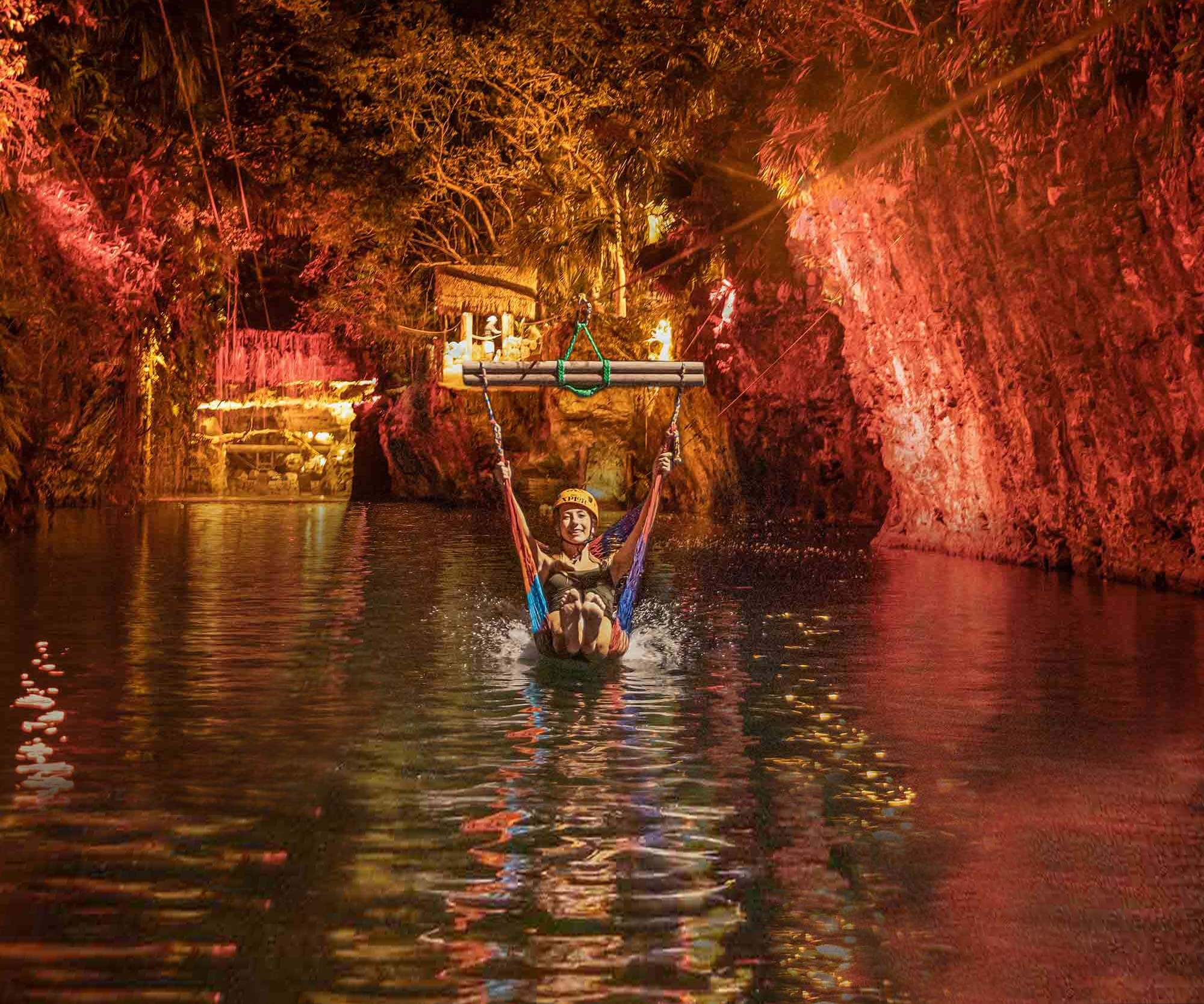 Ride a hammock-style zip-line and take a dip into a cenote at Xplor Fuego